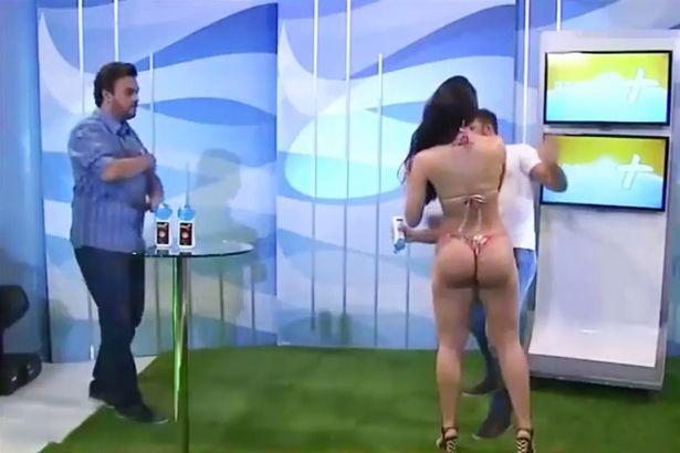 Bikini Model Slaps TV Host After He Grabs Her Butt During Creepy Sunscreen Demonstration