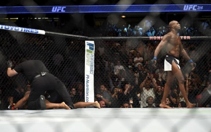 UFC 214 Highlights: Jon Jones DESTROYS Daniel Cormier with third-round KO; calls out Brock Lesnar, takes photos with The Rock